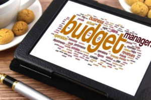 Computer Tablets with Budget Word Cloud - Photo Economics of Being a Woman