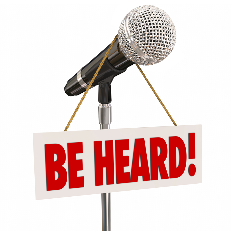 Be Heard Sign Hanging on Microphone